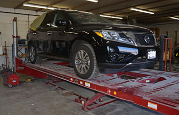 Car on a Lift at M & G Collision Specialists